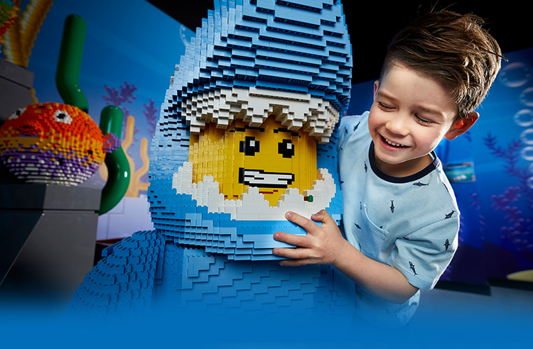 boy with lego figure dressed as shark